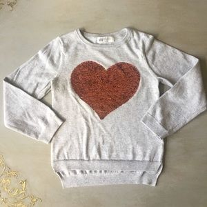 Girls H&M flip sequin heart sweater. H&M size 4-6